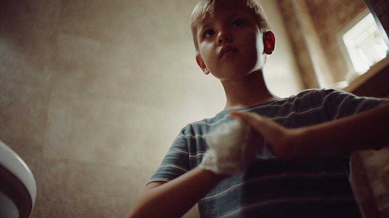 Kid fixing his hand